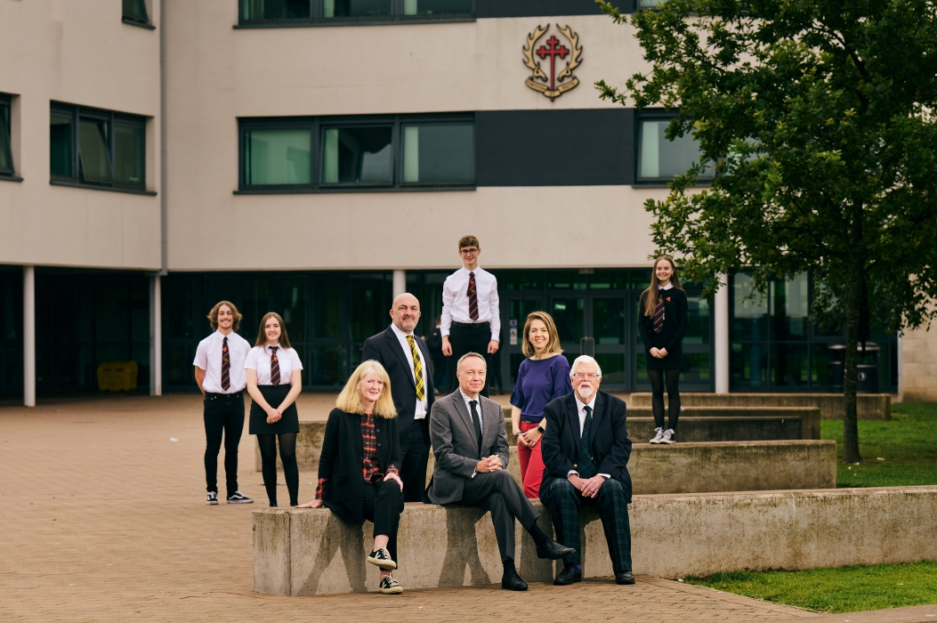 Young Enterprise Scotland CEO, Geoff Leask with SIFET Chair Hamish Buchan alongside pupils and staff at Broughton High School