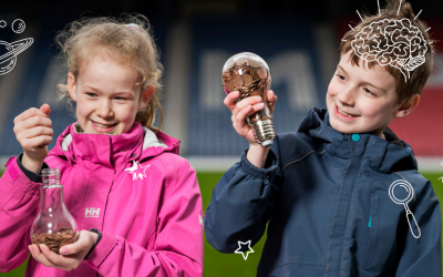 Two children holding lightbulbs filled with small change